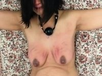 Floozy Endures a Brutal Tit Beating video on StupidCams