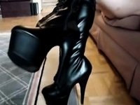Zipping up and wearing Darksome Knee High Boots video on StupidCams
