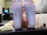 Foot Fetish Chick uses Feather on her own Bare Soles video on StupidCams