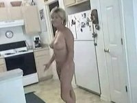 Aged sexy mom in nature's garb in kitchen showing off precious marangos and bawdy cleft video on StupidCams