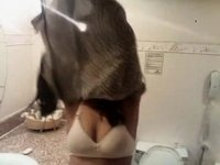Indian amateur strips in bathroom video on StupidCams