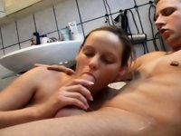 A steady blowjob in filled bathtub video on StupidCams