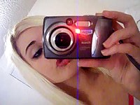 Selfshot blonde babe stripping video on StupidCams