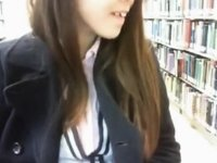 Riding red dildo on library video on StupidCams