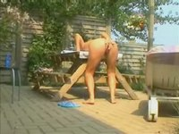 Stormy sex in the garden video on StupidCams