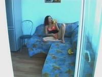 Girl masturbates on the sofa video on StupidCams