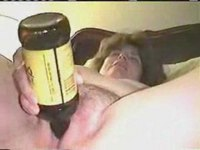 Bottle and cock for pervy video on StupidCams