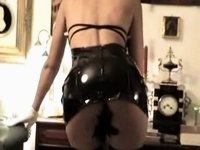 Hired wench wears hot latex dress video on StupidCams
