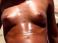 Sexy girl Topless on the Beach video on StupidCams