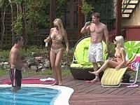 Two tanned blonde Euro babes fucking by the pool video on StupidCams