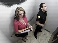 Busty office girl sucking security guard in elevator video on StupidCams