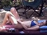 Reading and masturbating at camp video on StupidCams