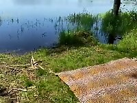 Teen amateur couple has outdoor sex by a lake in the summer video on StupidCams