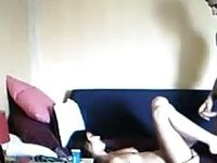 Girl does the naughty with her boyfriend on the sofa video on StupidCams