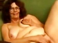 Horny old lady in glasses just loves anal toying on camera video on StupidCams