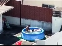 Amateur caught fucking in pool video on StupidCams